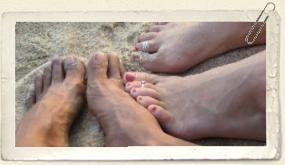 834694_feet_in_the_sand.jpg